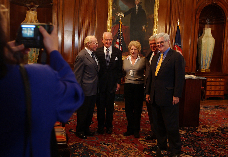 "Beverly Braun, of the House Radio TV Gallery, gets her picture taken with from left former House Speakers, Jim Wright, Tom Foley, current Speaker Dennis Hastert, and Newt Gingrich, after participating in ""The Changing Nature of the House Speakership."""
