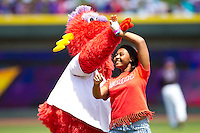 Winston-Salem Dash mascot Bolt dances with a young fan between innings of the game against the Potomac Nationals at BB&T Ballpark on April 25, 2012 in Winston-Salem, North Carolina.  The Dash defeated the Nationals 14-0.  (Brian Westerholt/Four Seam Images)