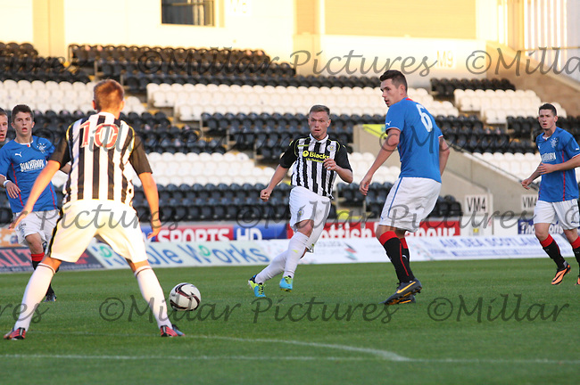 Kealan Dillon playing the ball through to Thomas Reilly watched by Kyle McAusland in the St Mirren v Rangers Scottish Professional Football League Under 20 match played at St Mirren Park, Paisley on 10.9.13.