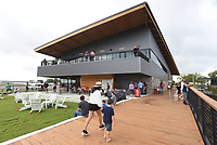 NWA Democrat-Gazette/FLIP PUTTHOFF <br />Visitors on Saturday Oct. 6 2018 stroll a walkway beside Lake Bentonville during the grand opening of Thaden Fieldhouse at the Bentonville airport. The fieldhouse features an exhibit hangar, porches that overlook the runway, a cafe and retail shop. It is also home of the OZ1 Flying Club.