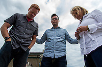 Chris Wong, Assistant Chaplain at the Kentucky Racetrack Chaplaincy, prays with Andy and Becky Muxlow at Churchill Downs in Louisville, Ky. on May 1, 2014.