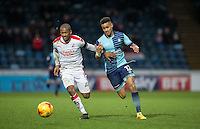 Paris Cowan-Hall of Wycombe Wanderers battles Lewis Young of Crawley Town during the Sky Bet League 2 match between Wycombe Wanderers and Crawley Town at Adams Park, High Wycombe, England on 25 February 2017. Photo by Andy Rowland / PRiME Media Images.