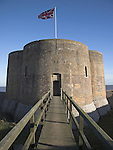 A unique quatrefoil Martello Tower at Slaughden, Aldeburgh, Suffolk, England. Martello towers were built along the coast as defences against invasion during the Napoloenic Wars. Between 1804 and 1812 the British authorities built a chain of towers based on the original Mortella tower to defend the south and east coast of England, Ireland, Jersey and Guernsey to guard against possible invasion from France, then under the rule of the Emperor Napoleon. A total of 103 Martello towers were built in England, set at regular intervals along the coast from Seaford, Sussex, to Aldeburgh, Suffolk.