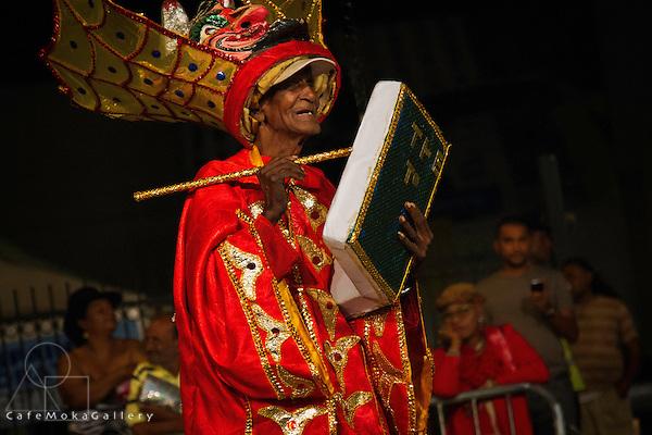 Traditional mas - Bookman Devil elder over 90 playing his mas