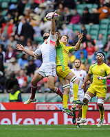 Jean Baptiste Mazoue of France (left) competes for the high ball with Con Foley of Australia during the iRB Marriott London Sevens at Twickenham on Saturday 11th May 2013 (Photo by Rob Munro)