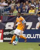Houston Dynamo midfielder Corey Ashe (26) dribbles. The New England Revolution defeated Houston Dynamo, 1-0, at Gillette Stadium on August 14, 2010.