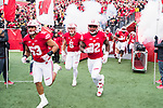 Wisconsin Badgers run onto the field prior to an NCAA College Big Ten Conference football game against the Iowa Hawkeyes Saturday, November 11, 2017, in Madison, Wis. The Badgers won 38-14. (Photo by David Stluka)