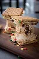 Pumpkin white chocolate s'mores.  Shaun and Brady Breese, owners of Urban Cookies with their sons Oliver, 8, and Charlie, 4, making pumpkin-flavored specialties in some reimaginings of recipies with the November holiday favorite gourd.