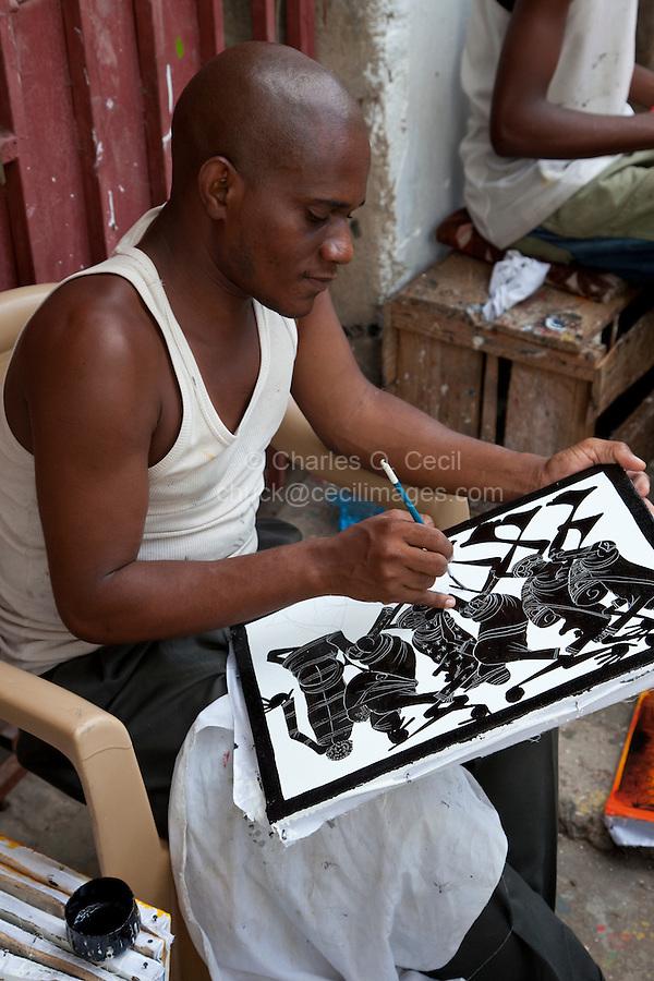 Zanzibar, Tanzania.  Tingatinga painter  at work in Stone Town.
