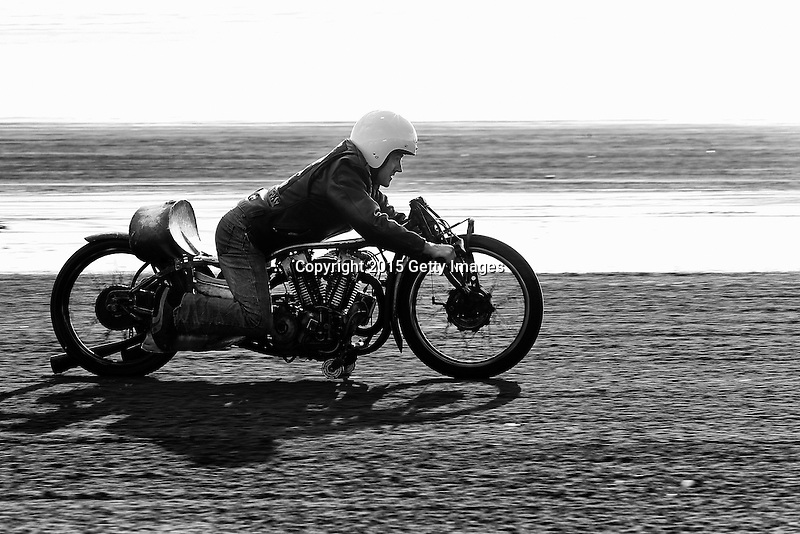 INVERCARGILL, NEW ZEALAND - NOVEMBER 27: Alex Winteringham of Invercargill rides the Burt Munro replica bike that was used in the film, The World's Fastest Indian during the 10th Anniversary of the 2015 Burt Munro Challenge at Oreti Beach on November 27, 2015 in Invercargill, New Zealand.  (Photo by Dianne Manson/Getty Images) *** Local Caption *** Alex Winteringham