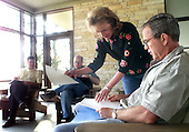 Crawford, TX - August 6, 2001 -- United States President George W. Bush meets with his senior staff at the Bush Ranch in Crawford, Texas, Monday morning, August 6, 2001. From left, national security staff Steve Biegun , deputy chief of staff Joe Hagin and staff secretary Harriet Miers. .Credit: Eric Draper - The White House via CNP
