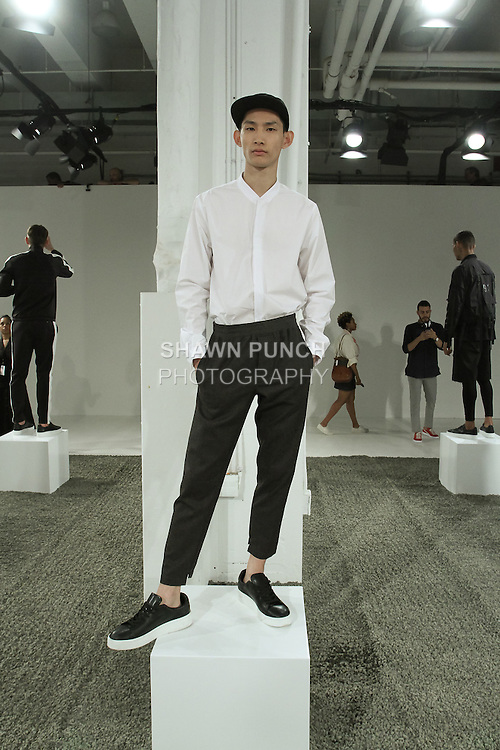 Model poses in an outfit from the Stampd Spring Summer 2017 collection on July 12, 2016 by Chris Stamp, at Skylight Clarkson Square during New York Fashion Week: Men's Spring Summer 2017.