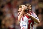 Nederland, Amsterdam, 24 oktober  2012.Champions League.Seizoen 2012-2013.Ajax-Manchester City 3-1.Christian Eriksen van Ajax juicht na het scoren van de 3-1 en wordt gefeliciteerd door Daley Blind