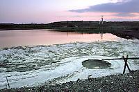 TSCHECHIEN, 07.2006 .Rozna bei Zdar nad Sazavou.Absetzbecken fuer hochgiftige Schlaemme der zum Rozna-Komplex gehoerenden chemischen Uranerz-Verarbeitungsanlage. Rozna ist das letzte in Betrieb befindliche Uran-Bergwerk in Mitteleuropa, es wurde 1957 eroeffnet. Der Uranbergbau in der Tschechoslowakei startete 1946 auf direktes Geheiss der Sowjetunion, welche das Material fuer ihre Atombomben brauchte..© Vaclav Vasku/EST&OST.Tailing pond next to chemical processing plant of uranium ore belonging to the Rozna complex near the city of Zdar nad Sazavou. Rozna is the site of the last deep uranium mine in operation in Central Europe. Uranium is mined here since 1957. Uranium mining in former Czechoslovakia started in 1946 with a direct order by the Soviet Union which needed the material for its atomic bombs.