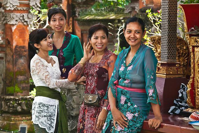 BALINESE WOMEN gather at PURA TAMAN SARASWATI during the GALUNGAN FESTIVAL - UBUD, BALI, INDONESIA