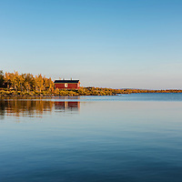 Red cabin of Sitojaure hut on lake Sitojaure, Kungsleden trail, Lapland, Sweden