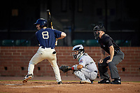 Mobile BayBears Brandon Sandoval (8) at bat in front of catcher Rodrigo Vigil (1) and umpire Mark Stewart during a Southern League game against the Jacksonville Jumbo Shrimp on May 7, 2019 at Hank Aaron Stadium in Mobile, Alabama.  Mobile defeated Jacksonville 2-0.  (Mike Janes/Four Seam Images)