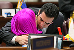 Nevada Sen. Ruben Kihuen, D-Las Vegas, congratulates Sen. Debbie Smith, D-Sparks, following Senate passage of a record $1.1 billion general fund tax package at the Legislative Building in Carson City, Nev., on Monday, June 1, 2015. Smith was wearing a wig following treatment for a malignant brain tumor. <br /> Photo by Cathleen Allison
