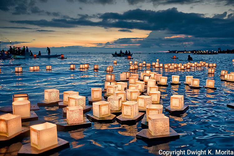 Floating Lanterns memorialize those that have passed away.  As the sun sets in the background, small boats with Buddhist monks and church volunteers help to launch and shepherd the small armada of lanterns ships.