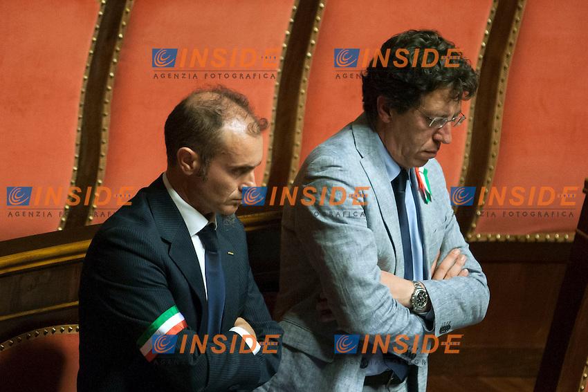 I senatori del Movimento 5 Stelle indossano delle fasce tricolori<br /> Roma 31-07-2014  Senato. Discussione sul DdL Riforme costituzionali che prevede anche la riforma del Senato. <br /> Photo Samantha Zucchi Insidefoto