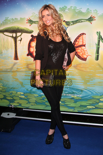 CHANTELLE HOUGHTON .UK Premiere of Cirque du Soleil's 'Totem' at the Royal Albert Hall, London, England, January 5th 2011..Full length black jacket top shoes leggings clutch bag platform slingbacks shooboots hand on hip smiling .CAP/ROS.©Steve Ross/Capital Pictures