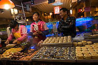 Night market, Old City, Lijiang, Yunnan, China. 10 November 2012.