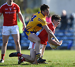Keelan Sexton of Clare in action against Emmet Carolan of Louth during their national League game in Cusack Park. Photograph by John Kelly.