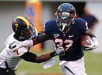 Virginia Cavaliers running back Perry Jones (33) runs past Southern Miss Golden Eagles running back Desmond Johnson (7) during the game at Scott Stadium. Virginia lost to Southern Mississippi 30-24. (Photo/Andrew Shurtleff)
