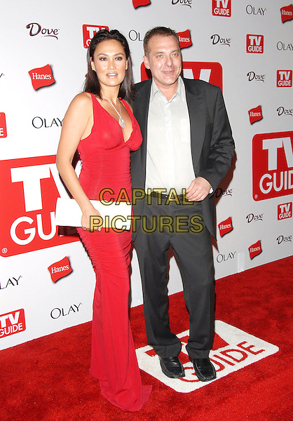 TIA CARRERE & TOM SIZEMORE.The 4th Annual TV Guide Post Emmy Party held at Social in Hollywood, California, USA..August 27th, 2006.Ref: DVS.full length red white clutch purse dress grey gray suit.www.capitalpictures.com.sales@capitalpictures.com.©Debbie VanStory/Capital Pictures