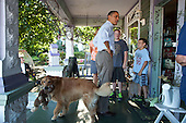 "Aug. 16, 2011.""I wasn't going to include this photo but everyone loved the dog with the stuffed animal in his mouth prancing through the scene as the President President talked with people at Grasshoppers store in LeClaire, Iowa, during the bus tour."" .Mandatory Credit: Pete Souza - White House via CNP"