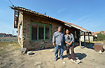 "Vassil Ivanov (left) lives in the Bulgarian town of Staro Oriahovo, where residents consider the term ""Roma""  to be negative and thus refer to themselves as Romanian-speaking Bulgarians. Ivanov is a member of the local United Methodist Church. Here he poses in front of his home with his adult daughter, Pauna Vassilev, who most of the year works as a elder caregiver in Greece."