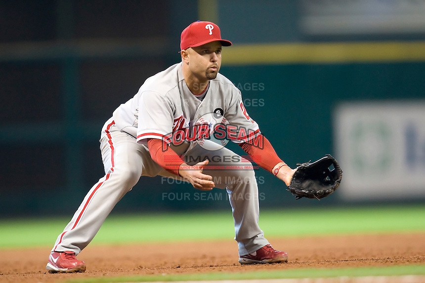 Philadelphia Phillies third baseman Placido Polanco #27 on defense during the Major League Baseball game against the Houston Astros at Minute Maid Park in Houston, Texas on September 14, 2011. Philadelphia defeated Houston 1-0 to clinch a playoff berth.  (Andrew Woolley/Four Seam Images)