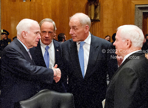 General John F. Kelly, USMC (Retired), right center, shakes hands with United States Senator John McCain ((Republican of Arizona), left, as US Senator Tom Carper (Democrat of Delaware), center left, and former US Secretary of Defense Robert Gates, right, look on as he arrives to testify before the United States Senate Committee on Homeland Security and Governmental Affairs confirmation hearing on his nomination to be Secretary, US Department of Homeland Security on Capitol Hill in Washington, DC on Tuesday, January 10, 2017.<br /> Credit: Ron Sachs / CNP
