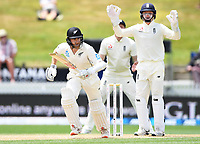 3rd December, Hamilton, New Zealand;  Kane Williamson takes a single as England wicketkeeper Ollie Pope looks on during play day 5 of the 2nd test cricket match between New Zealand and England at Seddon Park, Hamilton, New Zealand.