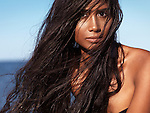 Young woman with wet long hair at the beach, artistic beauty portrait