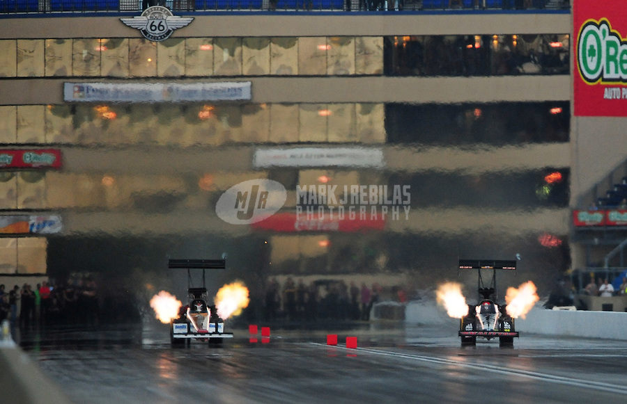 Jul. 1, 2012; Joliet, IL, USA: NHRA top fuel dragster driver Clay Millican (left) races alongside Doug Kalitta during the Route 66 Nationals at Route 66 Raceway. Mandatory Credit: Mark J. Rebilas-