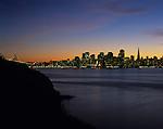 San Francisco skyline at sunset with city lights in bay from Treasure Island, San Francisco, California USA