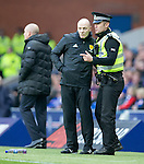 Police with the fourth official during the match