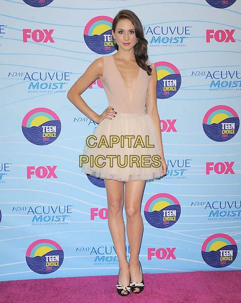 Troian Bellisario.Teen Choice Awards 2012 - Press Room held at Gibson Amphitheatre, Universal City, California, USA..July 22nd, 2012.full length beige tulle sleeveless dress skirt top hand on hip.CAP/RKE/DVS.©DVS/RockinExposures/Capital Pictures.