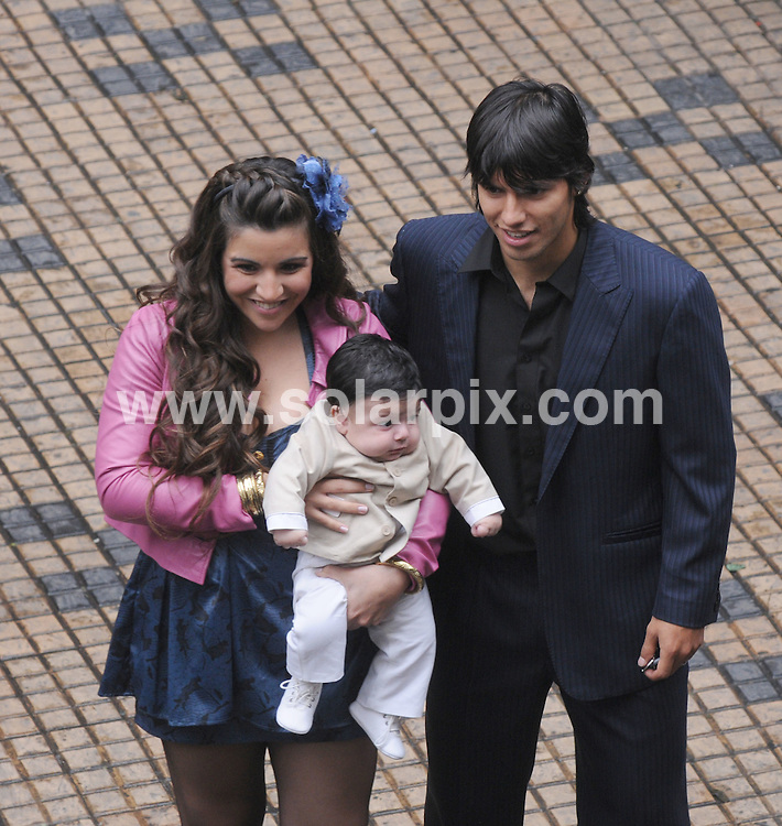 **ALL ROUND PICTURES FROM SOLARPIX.COM**.**SYNDICATION RIGHTS FOR UK AND SPAIN ONLY**.Soccer legend Diego Maradona's  grandson, Benjamin, four months old, was christened at Nuestra Senora Church, in the Balvanera neighborhood, in Buenos Aires. Benjamin is son of Maradona youngest daughter Giannina, 20, and Athletico Madrid player, Sergio 'Kun' Aguero, 21. The baby's godmother was Dalma Maradona, sister of Giannina, and the godfather was a friend of Aguero. Giannina and 'El Kun' seemed to be happy, despite the rumours of an affair of him with dancer Luisana Varacalli. Buenos Aires, Argentina. 21 June 2009..This pic: Diego Maradona's daughter Giannina and Kun Aguero..JOB REF:  9310 PRT (Perfil)       DATE: 21_06_2009.**MUST CREDIT SOLARPIX.COM OR DOUBLE FEE WILL BE CHARGED**.**ONLINE USAGE FEE GBP 50.00 PER PICTURE - NOTIFICATION OF USAGE TO PHOTO @ SOLARPIX.COM**.**CALL SOLARPIX : +34 952 811 768 or LOW RATE FROM UK 0844 617 7637**
