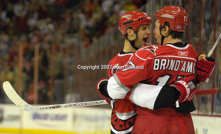 Carolina Hurricanes' Chad LaRose is congratulated by captain Rod Brind'Amour, right, after scoring the winning goal against the Vancouver Canucks during their game Monday, Oct. 22, 2007 in Raleigh, NC. The Hurricanes won 3-1.
