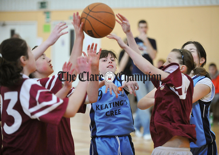 Aisling Cahir of Cooraclare in action against the Parish Panthers, Doora Barefield defence during the Community Games U-13 basketball finals at St Flannan's, Ennis. Photograph by John Kelly.