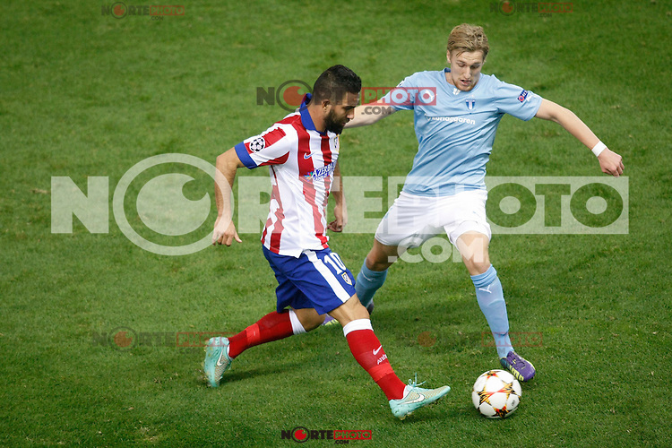 Atletico de Madrid´s Arda Turan (L) and Malmo´s Forsberg during Champions League soccer match between Atletico de Madrid and Malmo at Vicente Calderon stadium in Madrid, Spain. October 22, 2014. (ALTERPHOTOS/Victor Blanco)