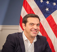 Greek Prime Minister Alexis Tsipras in New York City Hall at a meeting with New York Mayor Bill de Blasio on Thursday, October 1, 2015. The PM and the Mayor exchanged pleasantries during a brief photo op for the press. The International Monetary Fund has been criticized for promoting its punishing austerity programs related to Greece's massive debt and weak economy.   (© Richard B. Levine)