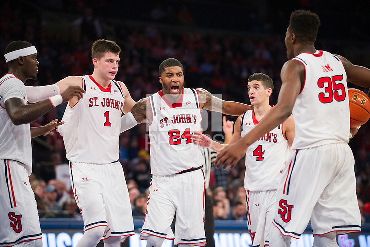 NEW YORK, NY - Sunday December 13, 2015: St. John's comes in for a huddle against Syracuse as the two square off during the NCAA men's basketball regular season at Madison Square Garden in New York City.  St. John's would go on to win 84-72.