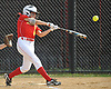 Janae Barracato #8, Sacred Heart Academy third baseman, connects for a tape measure-type solo home run that sailed well beyond the the right field fence in the bottom of the first inning of a CHSAA varsity softball game against Kellenberg at Greis Park in Lynbrook on Tuesday, April 11, 2017. Sacred Heart went on to win by run rule 9-0 after four and a half innings of play.