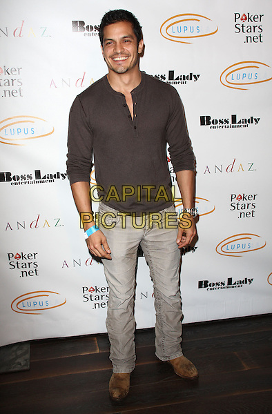 "NICHOLAS GONZALEZ. Lupus LA Raises Awareness with ""Get Lucky for Lupus"" held At Andaz Hotel, West Hollywood, California, USA..February 25th, 2010.full length shirt jeans denim black.CAP/ADM/KB.©Kevan Brooks/AdMedia/Capital Pictures."