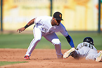 Surprise Saguaros Andy Ibanez (1), of the Texas Rangers organization, tags Drew Jackson (18) sliding into second base during a game against the Peoria Javelinas on October 20, 2016 at Surprise Stadium in Surprise, Arizona.  Peoria defeated Surprise 6-4.  (Mike Janes/Four Seam Images)