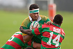 K. Vea tries to bust through the tackles of M. Baird & P. Vuli. Counties Manukau Premier Club Rugby round 5 game between Waiuku and Drury played at Waiuku on the 12th of May 2007. Waiuku led 33 - 0 at halftime and went on to win 57 - 5.