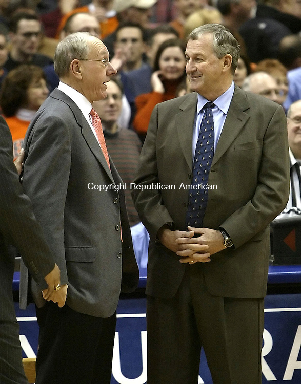 SYRACUSE, NY 16 JANUARY 2005 011605BZ07-      Syracuse head coach Jim Boheim, left, talks wiith UConn head coach Jim Calhoun before the start of their<br />  game at the carrier Dome at Syracuse University Monday night. <br /> Jamison C. Bazinet Republican-American